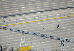 © Licensed to London News Pictures. 17/04/2020. Dover, UK. A driver makes his way past deserted queue lines at Dover docks in Kent. Europe's busiest port remains open with freight traffic continuing to run - but P&O have suspended all passenger services between Dover and Calais. The government have announced that lockdown will continue for another three weeks. The public have been told they can only leave their homes when absolutely essential, in an attempt to fight the spread of coronavirus COVID-19 disease. Photo credit: Peter Macdiarmid/LNP