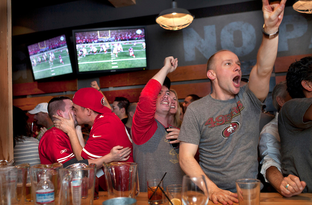 This is the moment when the 49ers scoed the winning touchdown to send San Francisco 49ers to the Superbowl. San Francisco 49er fans watch their team win the NFC Championship game to advance to the Superbowl at HiTops bar in the Castro District of San Francisco.