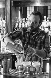 Owner Justin Burrow pours a trio of cocktails at Bad News Bar. (Editorial)