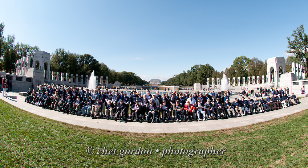 WWII Veterans and their escorts onboard the Hudson Valley Honor Flight pose at the WWII Memorial in Washington, DC on Saturday, October 18, 2014. Seventy-five veterans from the Westchester County (NY) area toured the WWII Memorial and Arlington National Cemetery on the inaugural flight from Westchester County Airport in White Plains, NY. Hudson Valley Honor Flight is a chapter of the Honor Flight Network, which provides free flights for WWII Veterans and tours of the WWII Memorial constructed in their honor, and other sites in the nation's capital.  © www.chetgordon.com