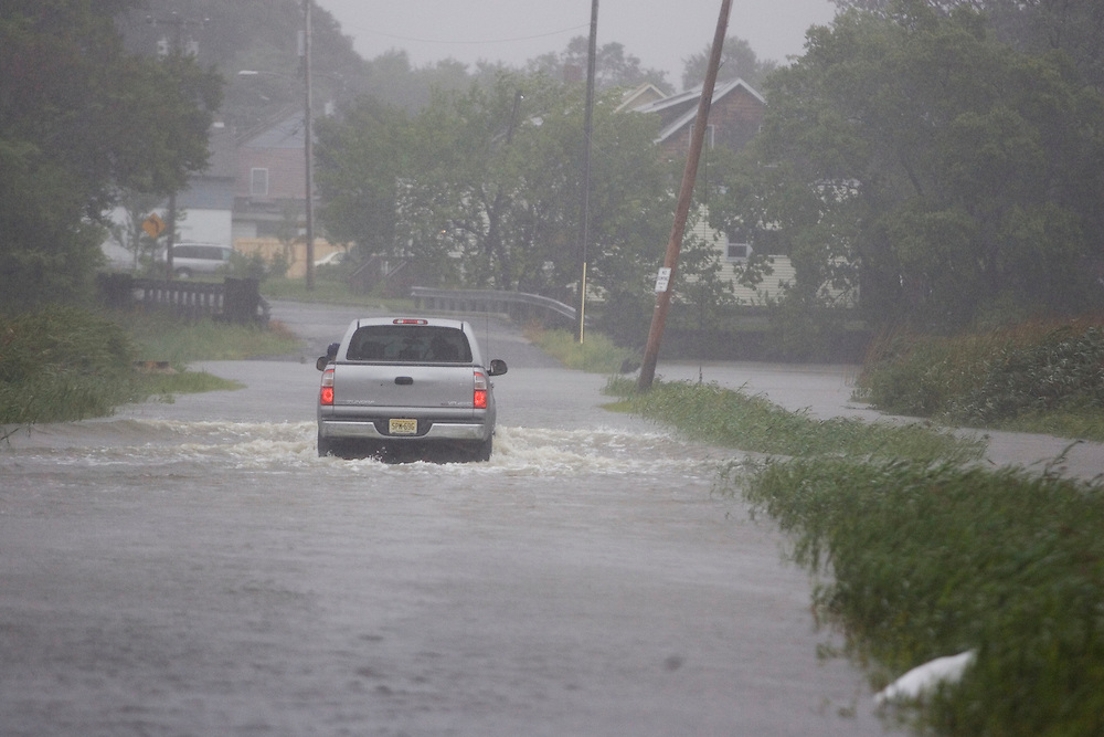 (PPAGE1) Port Monmouth  9/2/2006 A truck barrels through high water on Broadway.    Michael J. Treola Staff Photographer.....MJT