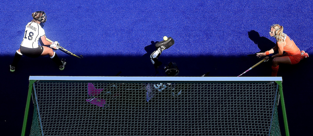 Germany's goalkeeper Kristina Reynolds (C) stops a shot on goal during the women's semifinal field hockey Netherlands vs Germany match of the Rio 2016 Olympics Games at the Olympic Hockey Centre in Rio de Janeiro on August 17, 2016. / AFP / MANAN VATSYAYANA        (Photo credit should read MANAN VATSYAYANA/AFP/Getty Images)