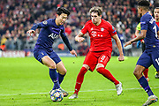 Tottenham Hotspur forward Heung-Min Son (7) tries to get to shoots towards the goal challenged by Bayern Munich defender Javi Martínez (8) during the Champions League match between Bayern Munich and Tottenham Hotspur at Allianz Arena, Munich, Germany on 11 December 2019.