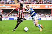 Brentford Midfielder Florian Jozefzoon (7) and Queens Park Rangers Midfielder Luke Freeman (7) battle for the ball during the EFL Sky Bet Championship match between Brentford and Queens Park Rangers at Griffin Park, London, England on 21 April 2018. Picture by Stephen Wright.