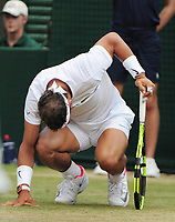 Tennis - 2017 Wimbledon Championships - Week Two, Monday [Day Seven]<br /> <br /> Men's Singles, Fourth Round<br /> <br /> Rafael Nadal (SPA) vs. Gilles Muller (LUX)<br /> <br /> Rafael Nadal drops to his knees after a long rally on Court 1<br /> <br /> COLORSPORT/ANDREW COWIE
