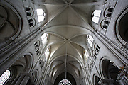 SENS, FRANCE - JUNE 28 : A view from below of the nave ceiling looking towards the portal, in St Stephen's Cathedral, on June 28, 2008 in Sens, Burgundy, France. St Stephen's was the first Gothic Cathedral to be built in France and the architect, William of Sens, was also influential in the building of Canterbury Cathedral. Construction began c. 1135-1140, and is mainly 12th century, but was not completed until the 16th century. The nave has a high vaulted Gothic ceiling with tiered arches to the either side. (Photo by Manuel Cohen)