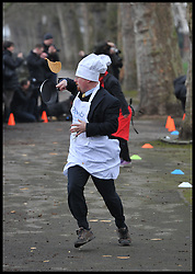 Julian Huppert Lib dem MP takes part in the MP's and Lord. race against political Journalist in the Rehab Parliamentary Pancake Shrove Tuesday race a charity event which sees MPs and Lords joined by media types in a race to the finish. Victoria Tower Gardens, Westminster, Tuesday February 12, 2013. Photo By Andrew Parsons / i-Images