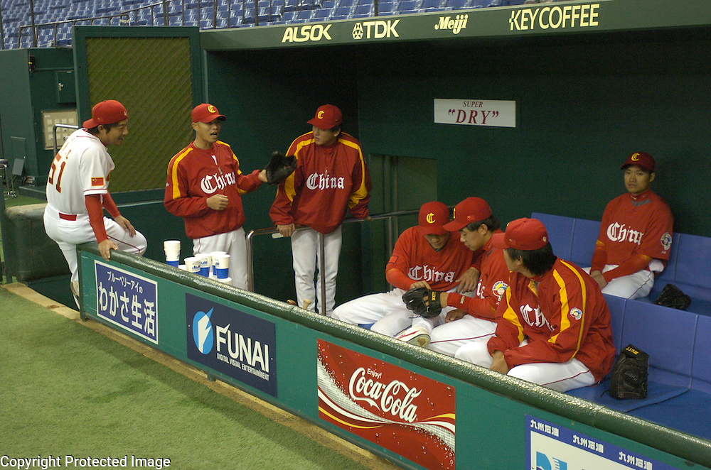 Team China relax in the dugout before the start of Game 5 against Chinese Taipei in the World Baseball Classic at Tokyo Dome, Tokyo, Japan.
