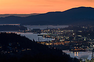 View of North Vancouver from Burnaby Mountain Conservation Area in Burnaby, British Columbia, Canada. This view shows the industry of North Vancouver along Burrard Inlet from the Second Narros Bridge through to the Lions Gate (First Narrows) as well as Stanley Park and English Bay.