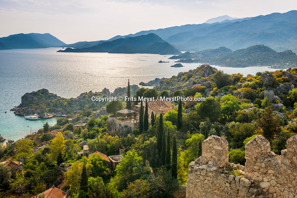 Kalekoy, Kekova, Turkey, April 2017.  Kekova includes Ucagiz (formerly Theimussa), a village on the coastline, Kalekoy (Simena) village with its famous fortress, and Kekova Island that stretches out to the historical sunken city across from Kalekoy. With its many small bays along the rugged  mediterranean coast, and a great safety standard, Turkey is well suited for camper tourism. Photo by Frits Meyst / MeystPhoto.com