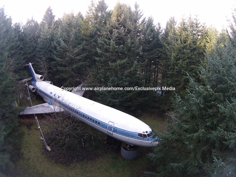 Man Lives In A Boeing 727 In The Middle Of The Woods<br /> <br /> Bruce Campbell is an inventive engineer who bought a retired Boeing 727 aircraft fuselage and upcycled it into an unusual and innovative home. The huge 3-engine commercial airliner is propped up on concrete pillars in a suburban wooded area outside of Portland, Oregon, and has its own driveway.<br /> <br /> The aircraft features a makeshift shower, but he is still working to install a working lavatory and to restore some of the plane's original interior elements, like seating and lights. Campbell lives in this plane 6 months every year, and spends the other part of the year in Japan, where he is also looking to buy and similarly re-use a retired Boeing 747 fuselage. The 10 acres where he's building his Oregon home cost $23,000 when he bought them in his 20s, and the plane set him back $220,000.<br /> ©www.airplanehome.com/Exclusivepix Media