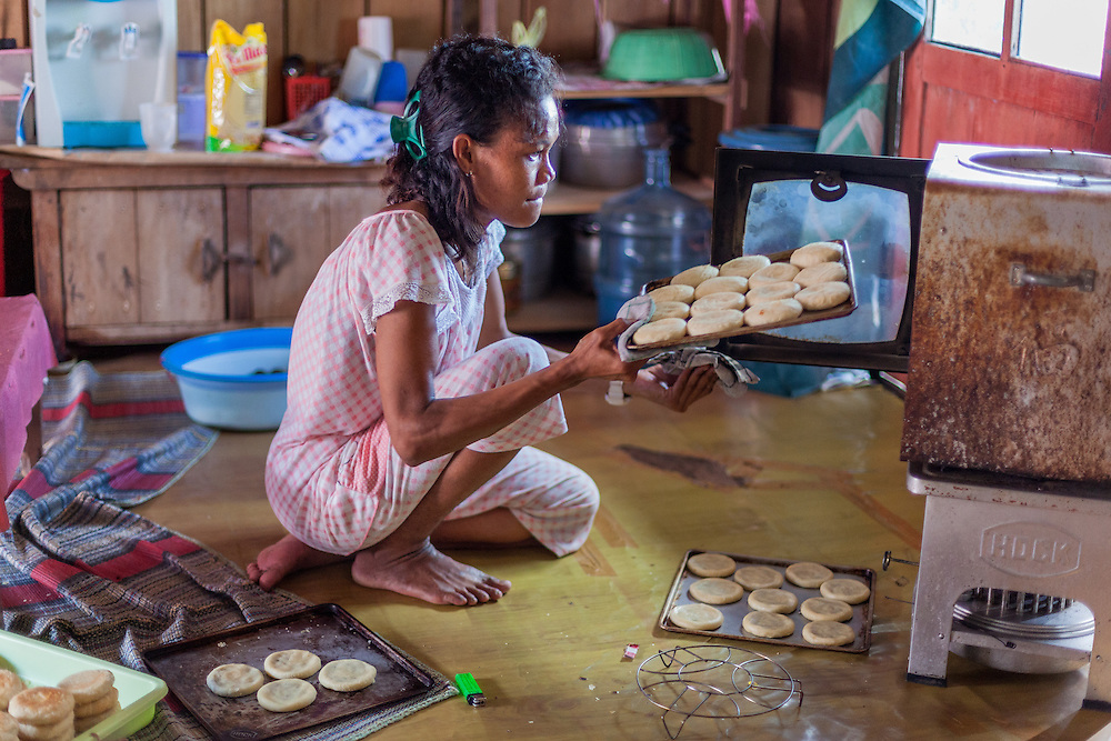 Ibu Siti started a small home business of baking Pia cakes to earn extra money and help her husband and buy household items like rice and milk.  She earns $30 per batch.