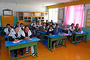 GOBI DESERT, MONGOLIA..09/03/2001.Bayanhongor (Bayankhongor). School girls in class room during English lesson..(Photo by Heimo Aga).