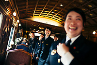 Staff on board the Seven Stars Kyushu luxury train in Japan.