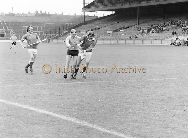 Two players get into a tussle to win possession of the slitor during the All-Ireland Senior B Hurling Championship Antrim v London at Croke Park on the 25th of June 1978. Antrim 1-16 London 3-7.