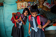 Ready for another day in the cozy, private school they have been attending since 2011, Jyoti, 11, (left) and her younger sister Poonam, 10, (right) are about to leave their newly built home in Oriya Basti, one of the water-contaminated colonies of Bhopal, central India, near the abandoned Union Carbide (now DOW Chemical) industrial complex, site of the infamous '1984 Gas Disaster'.