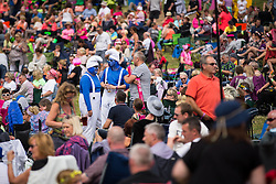 "© Licensed to London News Pictures . 09/08/2015 . Siddington , UK . "" Smurfs "" in the crowd . The Rewind Festival of 1980s music , fashion and culture at Capesthorne Hall in Macclesfield . Photo credit: Joel Goodman/LNP"