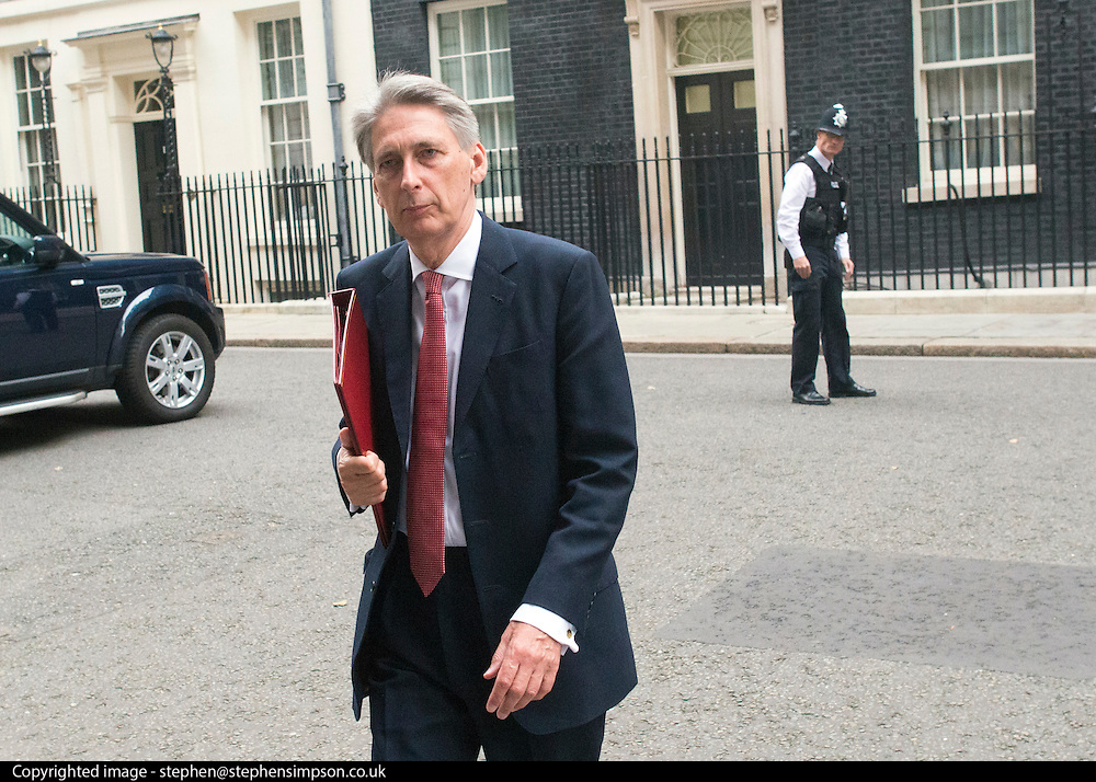 © Licensed to London News Pictures. 03/09/2014. London, UK Foreign Secretary Philip Hammond leaves Downing Street after the COBRA meeting on 3rd September 2014. Photo credit : Stephen Simpson/LNP