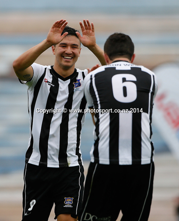 HB United's Ryan Tinsley is congratulated on his goal by Sean Lovemore. ASB Premiership Footbal Match. WaiBoP United v Hawkes Bay United, Rotorua International Stadium, Rotorua, New Zealand. Saturday, 20 December, 2014. Photo: John Cowpland / photosport.co.nz