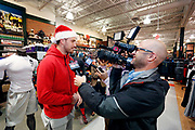 Corporate Event and Promotional Marketing Photographer in Kansas City - Kansas City Chiefs players, Travis Kelce, accompany members of a Football Club as they shop for items on their wish list at the Sports Matter Holiday Shopping event hosted by DICK'S Sporting Goods  in Leawood, Kansas. Photo by Colin E. Braley for Dick's Sporting Goods