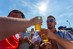 Fans share a drink whilst watching the outside big screen - Ryan Hiscott/JMP - 07/07/2018 - FOOTBALL - Ashton Gate - Bristol, England - Sweden v England, World Cup Quarter Final, World Cup Village at Ashton Gate