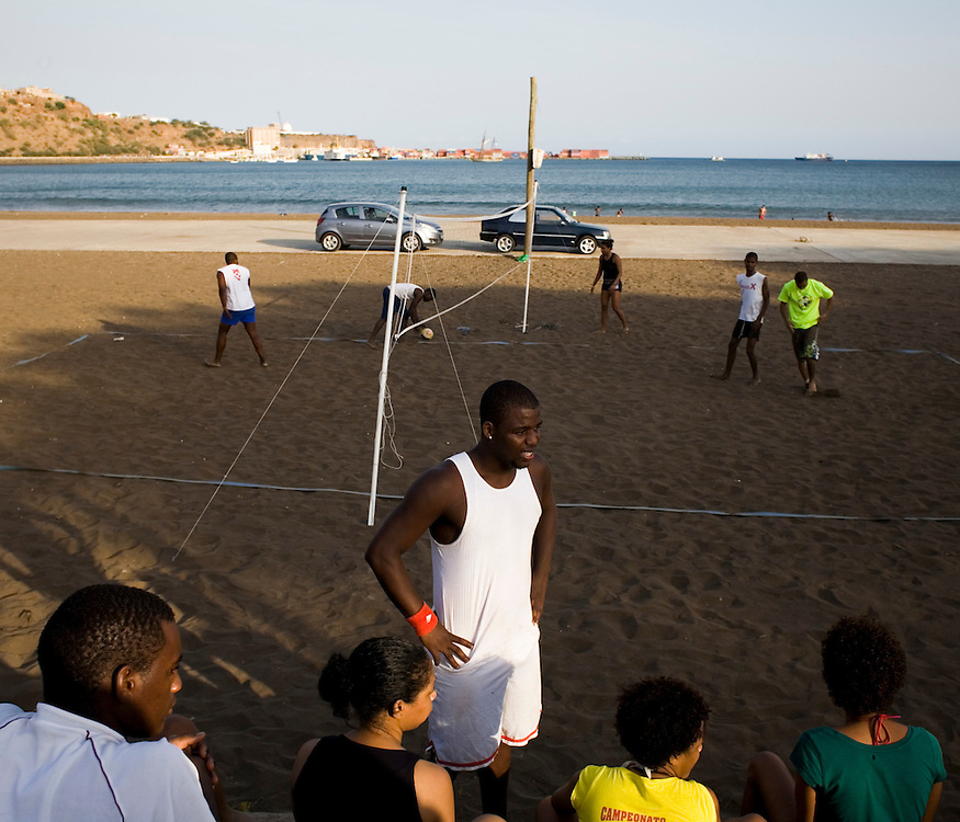 young people playing volleyball in a beach of Praia in Santiago Island, capital of Cape Verde.