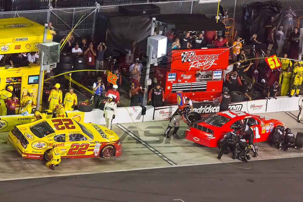 DAYTONA BEACH, FL - JUL 07, 2012:  Sam Hornish, Jr (22) and Kurt Busch (51) brings in theirs cars for service during the Coke Zero 400 at the Daytona International Speedway in Daytona Beach, FL.