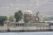 India, Rajasthan, Udaipur A boat ride in lake Pichola, Jag Mandir palace in the background.