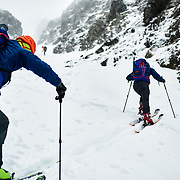 Coby and Corey skinning up the couloir in Dalvik, Iceland