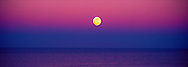 Panorama of Full Moon rising at Sunset over the Atlantic Ocean