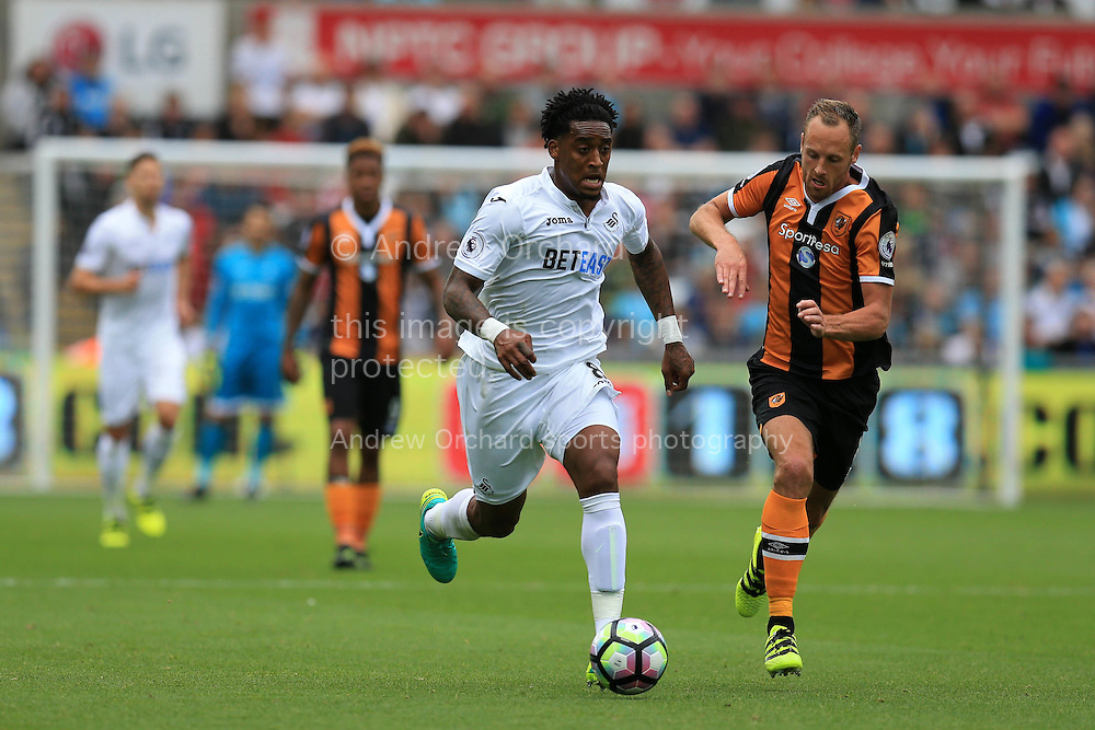 Leroy Fer of Swansea city &copy; breaks away from David Meyler of Hull city. Premier league match, Swansea city v Hull city at the Liberty Stadium in Swansea, South Wales on Saturday 20th August 2016.<br /> pic by Andrew Orchard, Andrew Orchard sports photography.