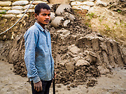 09 MARCH 2017 - BAGMATI, NEPAL:  A worker at a brick factory in Bagmati, near Bhaktapur. There are almost 50 brick factories in the valley near Bagmati. The brick makers are very busy making bricks for the reconstruction of Kathmandu, Bhaktapur and other cities in the Kathmandu valley that were badly damaged by the 2015 Nepal Earthquake. The brick factories have been in the Bagmati area for centuries because the local clay is a popular raw material for the bricks. Most of the workers in the brick factories are migrant workers from southern Nepal.           PHOTO BY JACK KURTZ