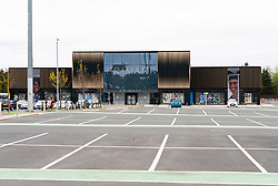 Edinburgh, Scotland, UK. 16 April 2020. Coronavirus lockdown continues in 4th week. Normally busy Ford Kinnaird retail shopping park Is virtually deserted. Primark store is closed and car park is almost empty. Iain Masterton/Alamy Live News