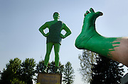 Footograph: Photograph of my right foot painted green in front of the statue of the Jolly Green Giant in Blue Earth, Minnesota USA