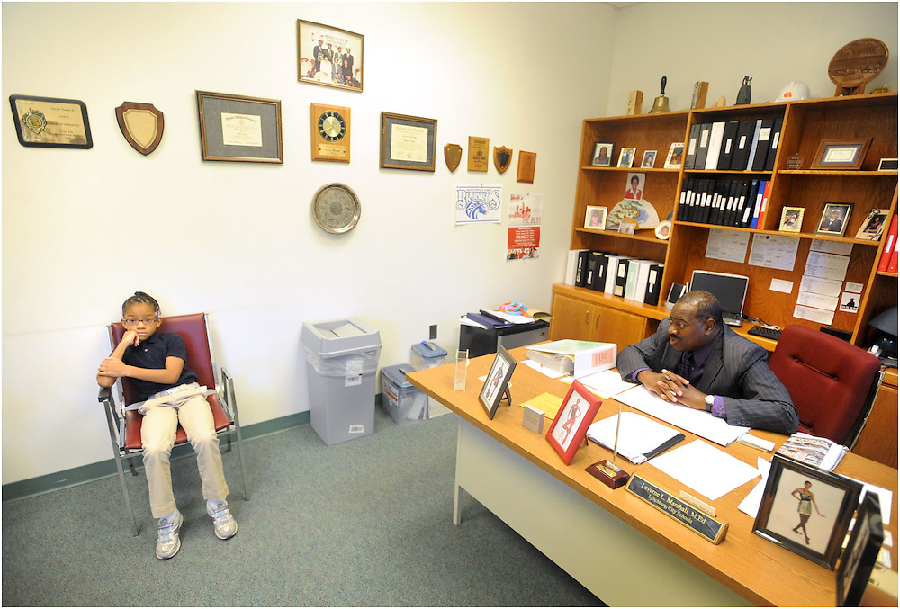 Adrian Smith meets with principal Leverne Marshal one on one to discuss an issue she was having with another student in class.