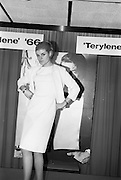 "08/02/1966<br /> 02/08/1966<br /> 08 February 1966<br /> Fashion Show at I.C.I. Hawkins House. Carole wearing ""Crimplene"" dress and jacket in beige by Elitwear."