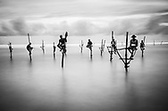 Stilt fishermen from Weligama, Sri Lanka.<br />