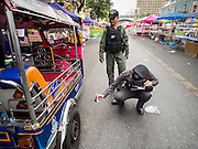 24 FEBRUARY 2014 - BANGKOK, THAILAND: Thai police investigate the scene of a grenade attack that took place Sunday evening in the Ratchaprasong district in Bangkok. At least four people, three of them children, were killed in political violence over the weekend in Thailand. One in Trat province, near the Cambodian border, and three in Bangkok, at the Ratchaprasong protest site. At the Ratchaprasong site a grenade was fired into a crowd killing a child and an adult. A second child, injured in the blast, died overnight in a Bangkok hospital.   PHOTO BY JACK KURTZ