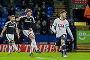 Brentford midfielder, on loan from Chelsea, John Swift  scores during the Sky Bet Championship match between Bolton Wanderers and Brentford at the Macron Stadium, Bolton, England on 30 November 2015. Photo by Simon Davies.