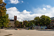 A view of the skate park in Vesterbro Copenhagen with church architecture in the background.