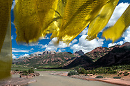ANGSAI, CHINA - JULY 23: Tibetan flags fly over mountains near the Mekong river in Angsai, on July 23, 2017 in Qinghai province, China. The region is part of Sanjiangyuan, the 'source of three rivers,' which will be China's first national park. Photo by Ann Hermes/The Christian Science Monitor