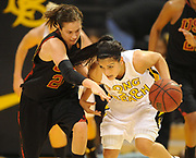 Dec 3, 2009; Long Beach, CA, USA; Long Beach State 49ers guard Karina Figueroa (20), right, is defended by Southern California Trojans guard Ashley Corral (24) at the Walter Pyramid. USC defeated Long Beach State 83-77.