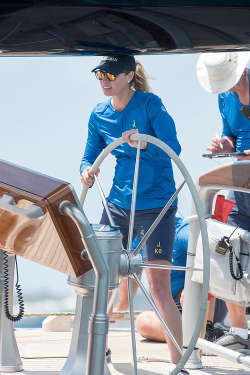 The Great Sound, Bermuda, 17th June America's Cup J Class parade. Kristy Hinze, Australian model and wife of  US entrepreneur James Clarke owner of Hanuman (JK6) at the wheel.