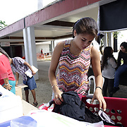 DECEMBER 1, 2017---HUMACAO, PUERTO RICO--<br /> Joan Diaz Velazquez, 18, a 2nd year microbiology student, does her laundry using loaner washer/dryers set up at the University of Puerto Rico's Humacao campus. Hurricane Maria damaged a lot of the structures and the school runs on generators since the power has not been repaired.<br /> (PHOTO BY ANGEL VALENTIN/FREELANCE)