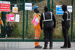 Harefield, UK. 22 July, 2020. Masked HS2 security guards arrive at a site for the HS2 high-speed rail link which had been occupied by activists from HS2 Rebellion in order to hinder tree felling works. Environmental activists continue to protest against HS2, which is currently projected to cost £106bn and will remain a net contributor to CO2 emissions during its projected 120-year lifespan, from a series of wildlife protection camps along its route.