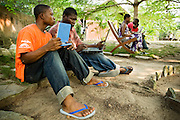 Students use laptops to browse the internet over a wireless network at the Kokrobitey Institute in the town of Kokrobitey, 30km west of Ghana's capital Accra on Sunday January 18, 2009. Sitting on the ground are Abass Aryee (L) and Oti Dodoo.