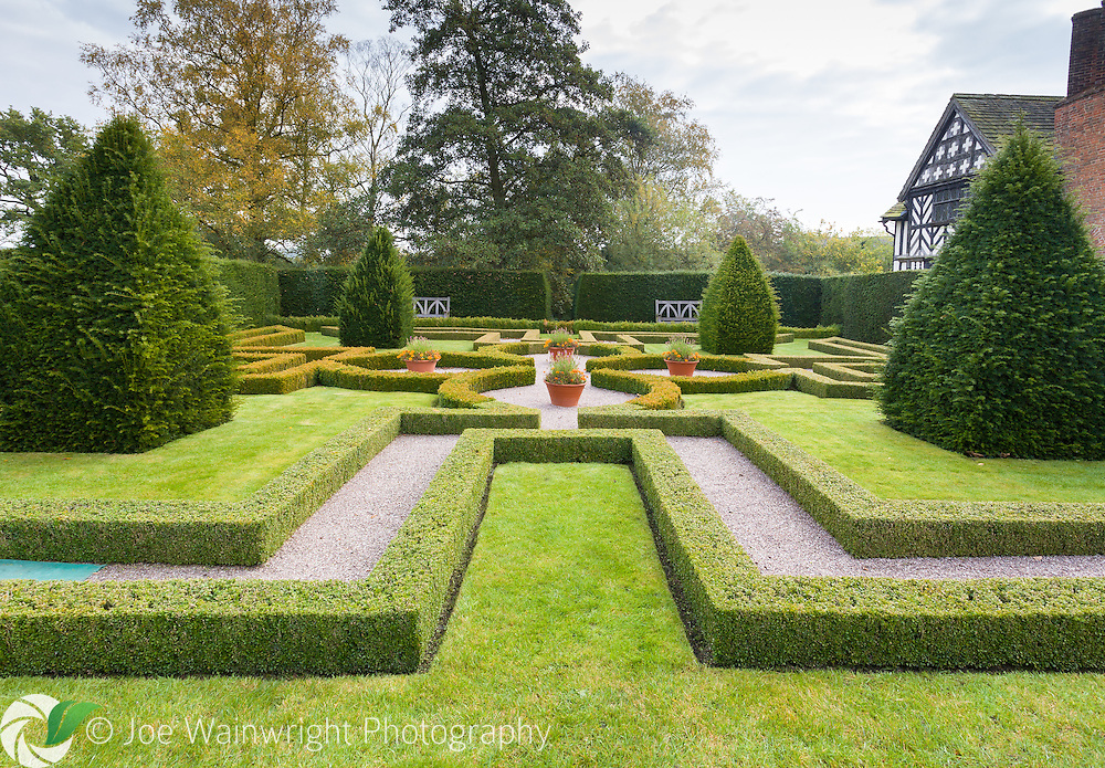 A recreated Elizabethan Knot Garden, in the grounds of the 16th century Little Moreton Hall, Congleton, Cheshire - a National Trust property. Photographed in October.
