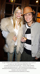 Singer MARK OWEN and MISS CHLOE BAILEY at a party in London on 16th February 2003.PHH 174