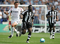 Photo: Paul Thomas. <br /> Bolton Wanderers v Newcastle United. Barclays Premiership. 11/08/2007. <br /> <br /> Goal scorer Obafemi Martins of Newcastle gets away from Gary Speed (L).