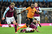Wolverhampton Wanderers striker (on loan from Bournemouth) Benik Afobe (19) is fouled by Aston Villa midfielder Mile Jedinak (15) during the EFL Sky Bet Championship match between Aston Villa and Wolverhampton Wanderers at Villa Park, Birmingham, England on 10 March 2018. Picture by Dennis Goodwin.